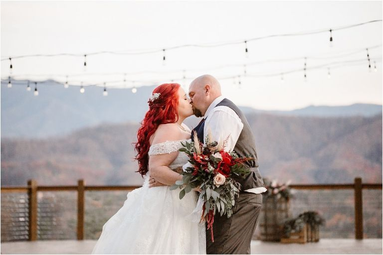 Bride and groom kissing at Micro-Wedding overlooking the Smokies
